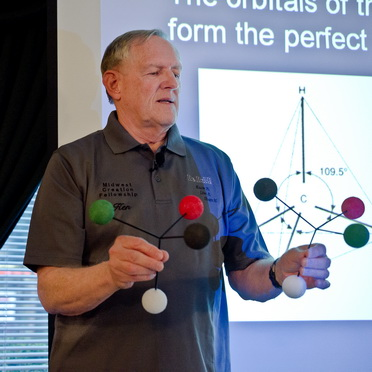 Dr. Kenneth Funk explaining mirror-image molecules - click for bio